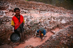 Gold Panning in Tailings, Porgera Gold Mine. (Water contains Sulpher, Mercury and Cyanide and is 70-80 degrees Celcius)
